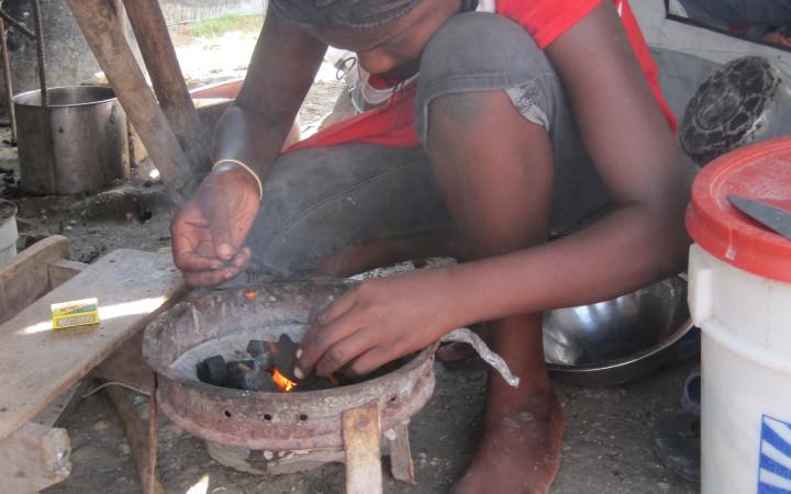 Lighting a cook stove