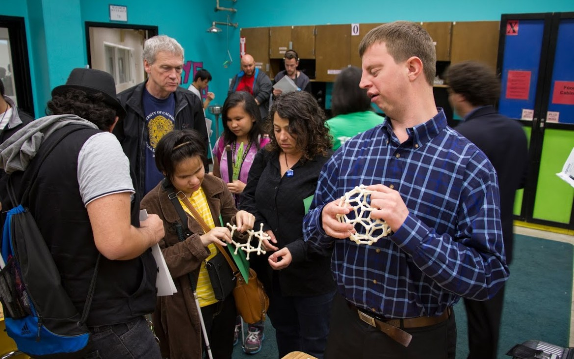 Hoby Wedler showing off his 3D printed molecules to a group of students.