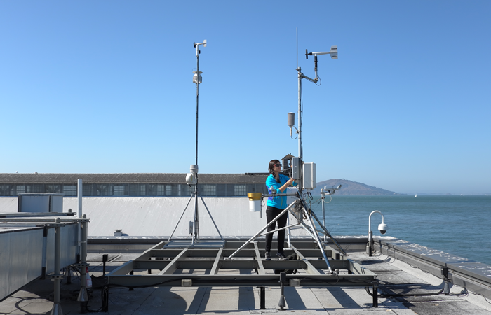 Alexis Shusterman performs maintenance on a rooftop carbon dioxide sensor at San Francisco's Exploratorium. Credit: Michael Wan